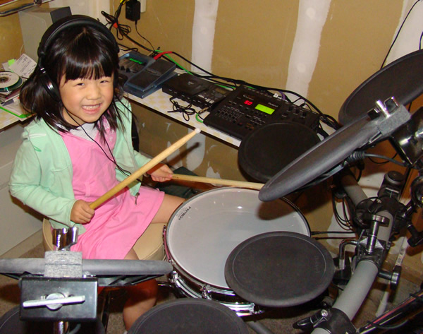 Faye on the Drums